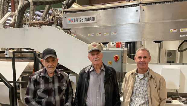The newest Davis-Standard extrusion coating line with John Clemmons, David Pitts, and Steve Pinette (from left).